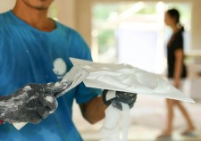 Plasterer mixing a plaster on a tray